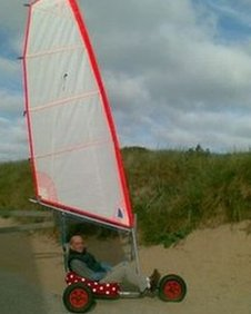 Ian Dibden in a mini sand yacht