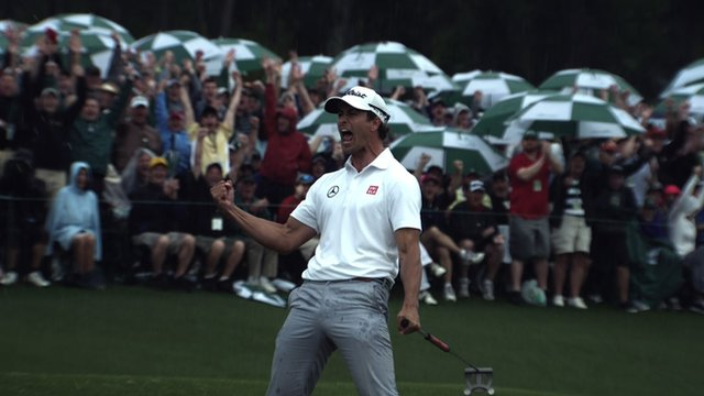 Adam Scott celebrates a putt on the 18th