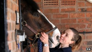 Police horse handler, Isabelle Collins, with Bud