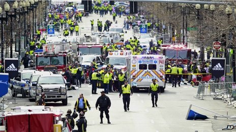Police clear the area at the finish line of the 2013 Boston Marathon following explosions