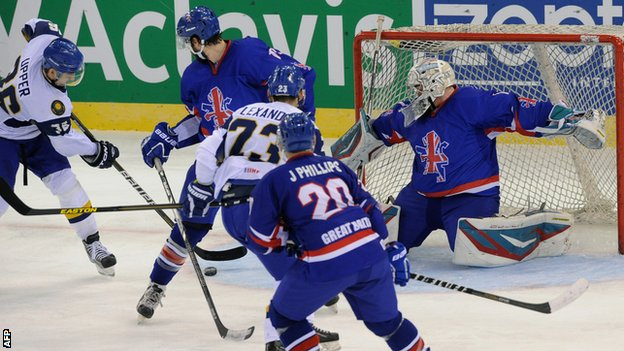 Great Britain players attempt to stop Dmitry Upper of Kazakhstan