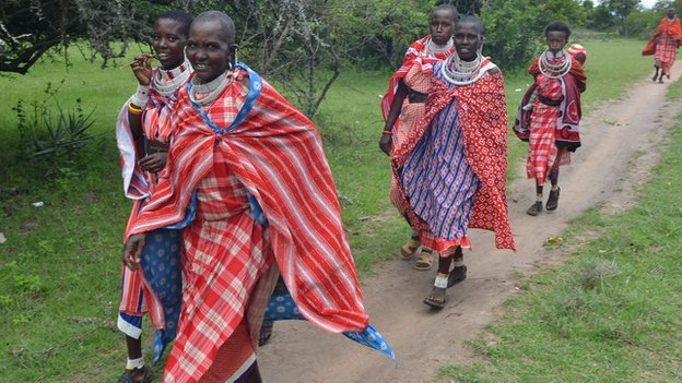 Maasai women walking to the protest meeting