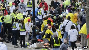 Medical officials help people at the sight of the explosion