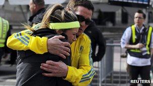 A woman is comforted by a man near a triage tent set up for the Boston Marathon after explosions went off at the 117th Boston Marathon in Boston, Massachusetts 15 April 2013