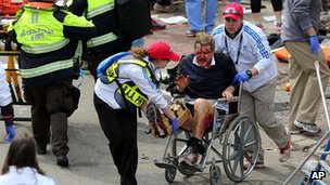 Medical workers aid injured people at the 2013 Boston Marathon following an explosion in Boston, 15 April 2013