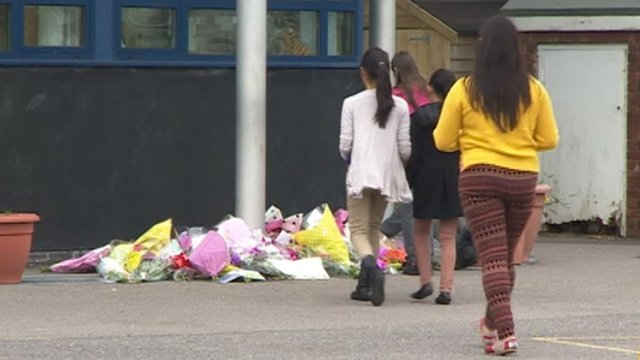 Tributes being laid outside St Joseph's Catholic Combined School in Poole where Ally Mullany was head teacher