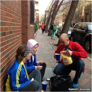 Ali Hatfield (sitting with friend) is given orange juice in Boston (Pic: Ramsey Mohsen)