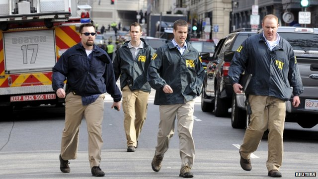 FBI agents arrive at the scene after explosions near the finish line of the Boston Marathon