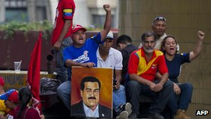 Supporters of Nicolas Maduro celebrate after the electoral authorities said he had won the election