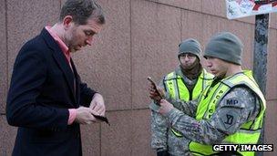 Military police checks ID on Massachusetts Avenue on April 16