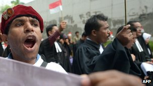 An Indonesian protester shouts slogans as religous leaders protest against Indonesian government failures to guarantee freedom of religion in Jakarta on 8 April 2013