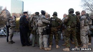 Swat team members and special police units assemble in the Boston Common on 16 April 2013