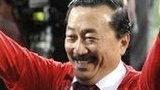 Cardiff City owner Vincent Tan celebrates on the pitch at the Cardiff City Stadium