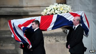 Pallbearers carry the coffin of Lady Thatcher as it arrives to be laid at the Crypt Chapel of St Mary on Tuesday