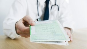 Doctor handing over prescription notes