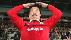 "Cardiff City owner Vincent Tan does the club celebration, the ""Ayatollah"""