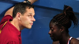 Ricky Simms (left) with Christine Ohuruogu