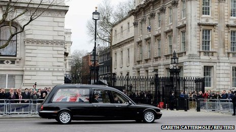 The hearse carrying the coffin of former British prime minister Margaret Thatcher makes its way past Downing Street