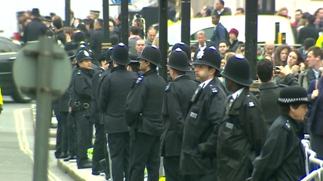 Police line the funeral procession route