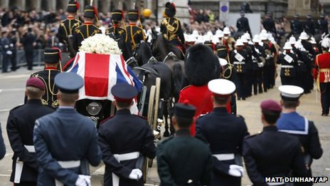 The coffin is carried on a gun carriage drawn by the King's Troop Royal Artillery