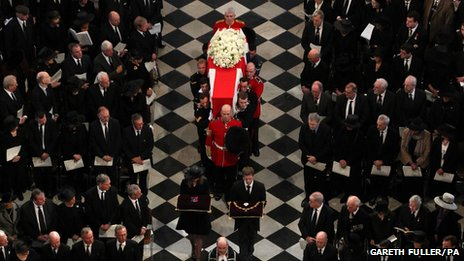 The funeral service at St Paul's Cathedral begins with Baroness Thatcher's coffin being borne through the vast structure by eight military personnel