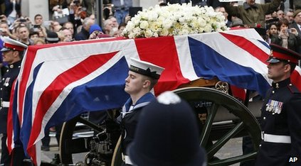 Lady Thatcher's coffin is carried through London's streets