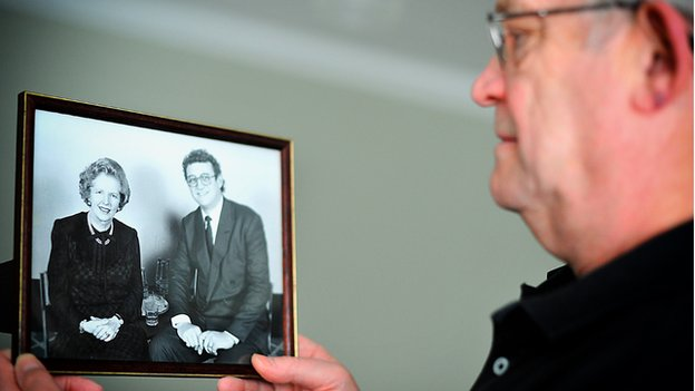 Bill Sharp holds a photograph of himself with Margaret Thatcher
