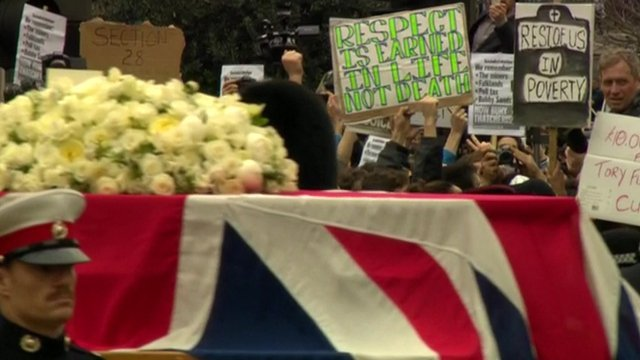 Protesters behind Baroness Thatcher's coffin