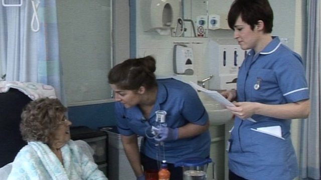 Nurses talking to a patient