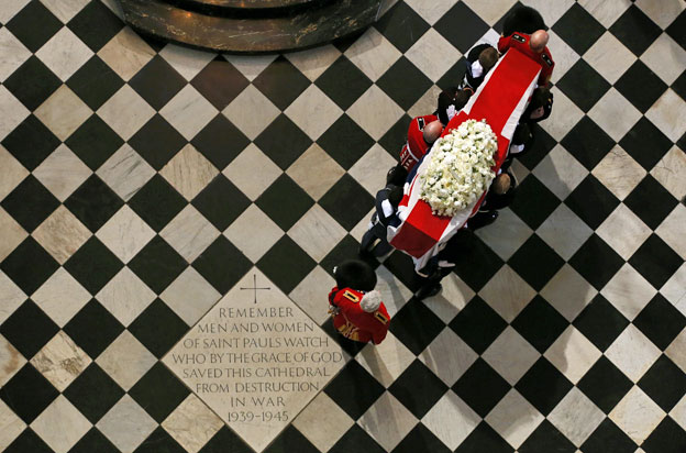 Margaret Thatcher's coffin being carried through St Paul's Cathedral