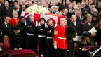 Britain's Queen Elizabeth (front left) and Mark Thatcher (right), son of former British prime minister Margaret Thatcher, watch as her coffin arrives in St Paul's Cathedral