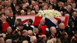Lady Thatcher's coffin makes its slow passage down the cathedral's aisle