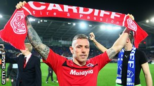 Craig Bellamy celebrates Cardiff's promotion to the Premier League