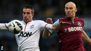 Manchester United's Robin van Persie (left) and West Ham's James Collins
