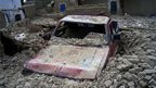 Car buried by earthquake rubble in Mashkel, Pakistan, 17 April 2013