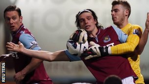 West Ham's Andy Carroll tussles with Manchester United's David De Gea