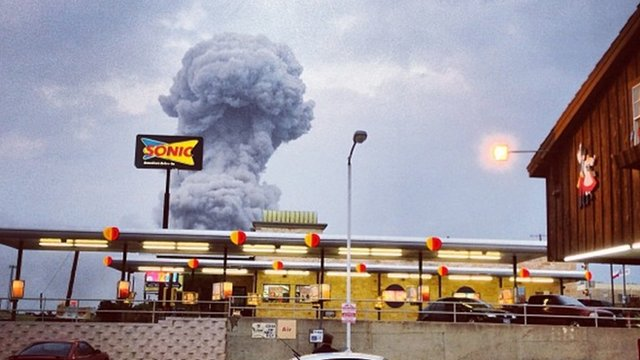 A plume of smoke rises from a fertilizer plant fire in West