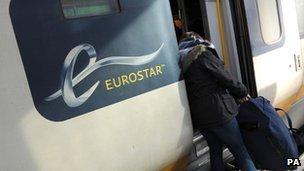 Passenger loading her bag onto a Eurostar train