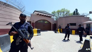 Police outside Mr Musharraf's house on the outskirts of Islamabad