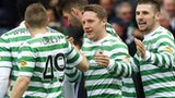 Kris Commons is congratulated by his Celtic team-mates