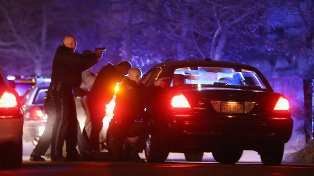 Police with guns drawn search for a suspect on April 19, 2013 in Watertown, Massachusetts
