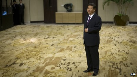"Xi Jinping  - China""s President Xi Jinping stands in his position marked by a red star on the carpet while he waits to shake hands with representatives of entrepreneurs during the annual Boao Forum for Asia in Boao on"