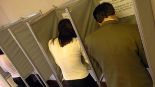 Voters in booths at polling station