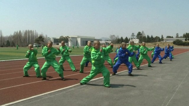 North Korean children training on the school's sports ground