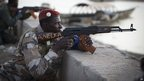 A Malian soldier pointing his gun in Gao, Mali - Saturday 13 April 2013