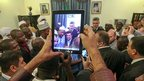 A man taking a pictures of Iran's President Mahmoud Ahmadinejad with academics in Niger - Monday 15 April 2013