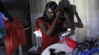 A Miss World South Sudan contestant fixes her hair, Juba, South Sudan - Saturday 13 April 2013