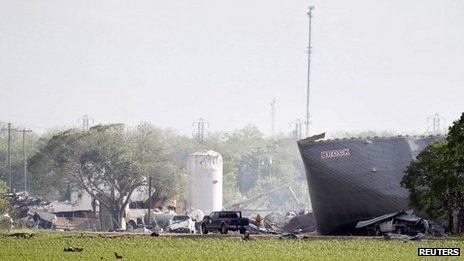 Workers are seen at the site of a fertilizer plant a day after a massive explosion in the town of West, near Waco