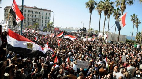 Egyptian demonstrators wave the national flag during a protest in Alexandria on January 25, 2013