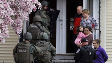 A Swat team searches for suspect in Watertown, on 19 April 2013